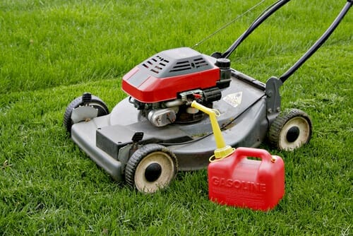 Lawn Mower and Gasoline Tank in the Field